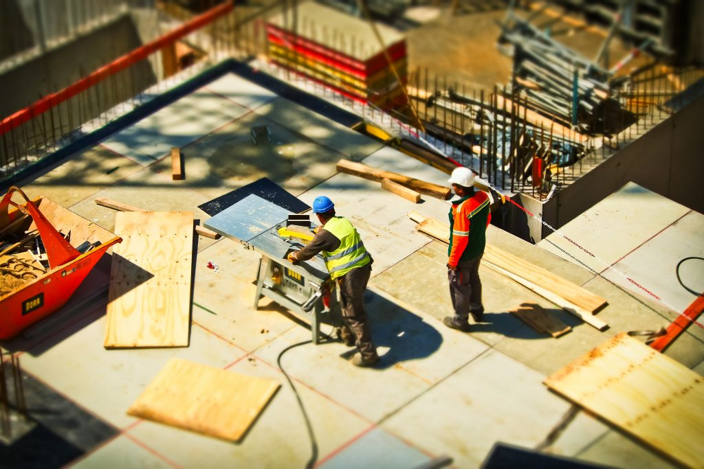 Two men working on a construction site with construction insurance