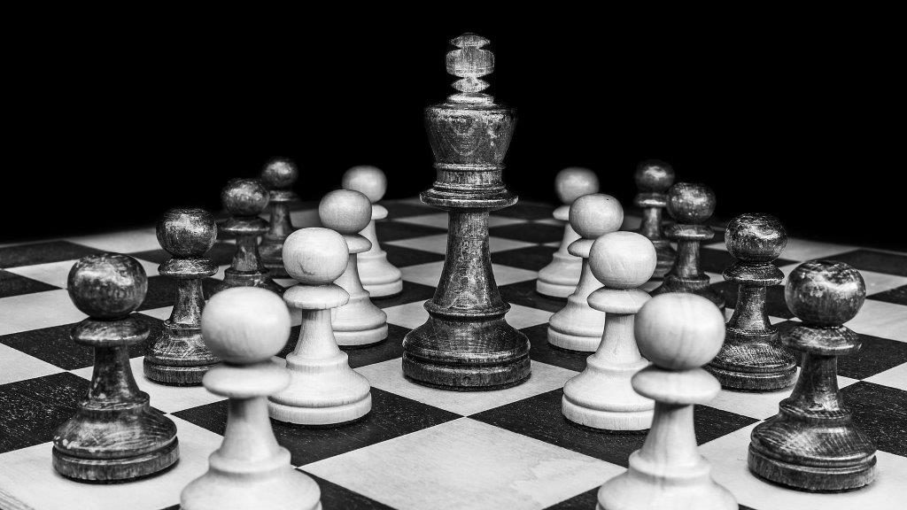black an white chess board with pawns and king