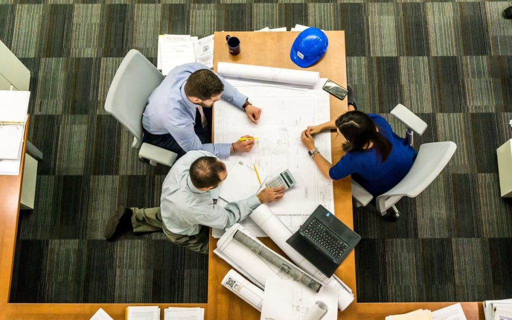 construction business people planning around a table