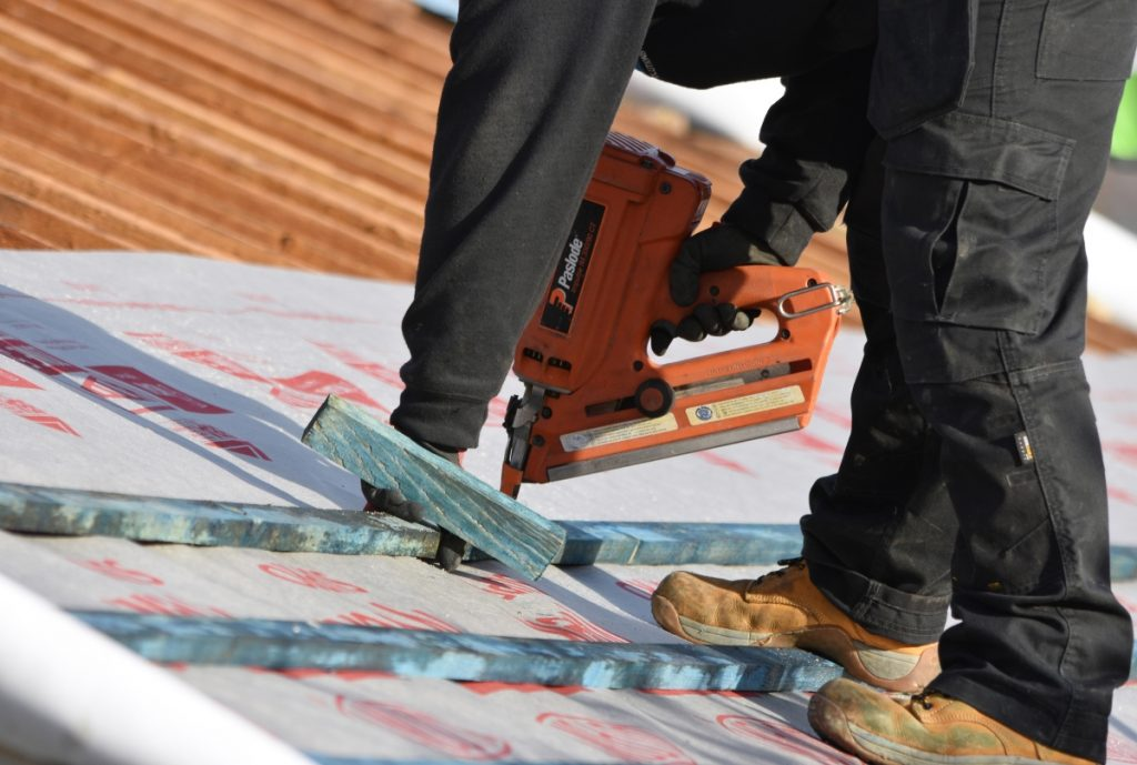 construction worker at work with site insurance