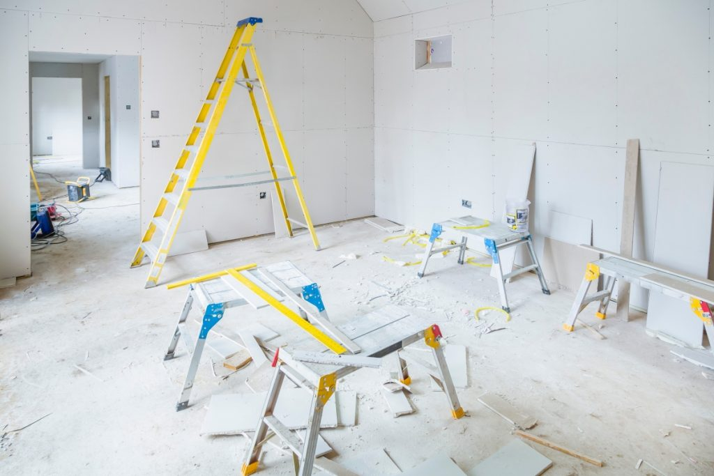 empty property being painted with commercial property insurance